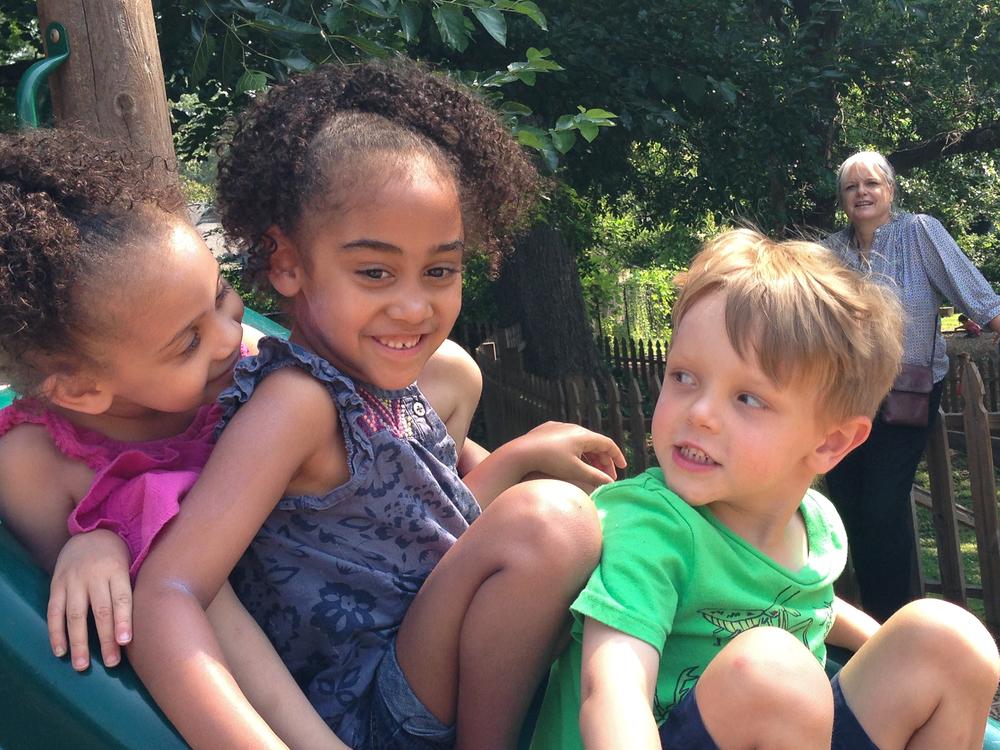 Lotus:  Bellamy, Leona and Aidan enjoying a beautiful day on the slide.