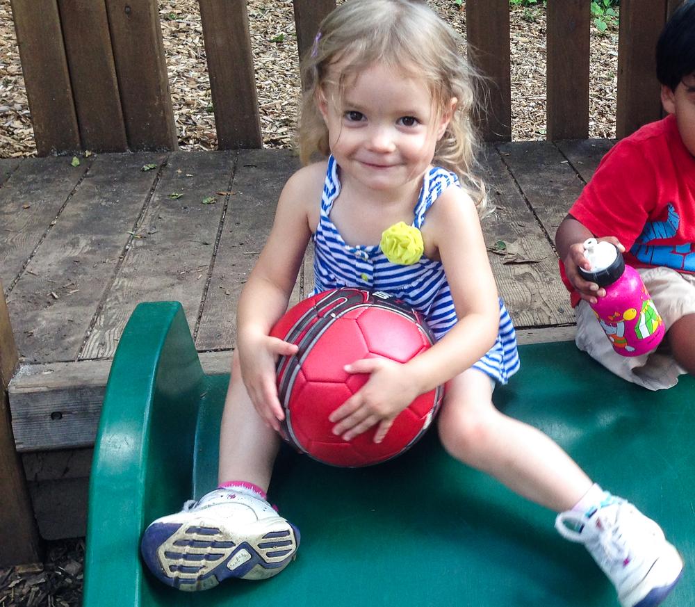 Lilies:  Isadora having fun on the slide!