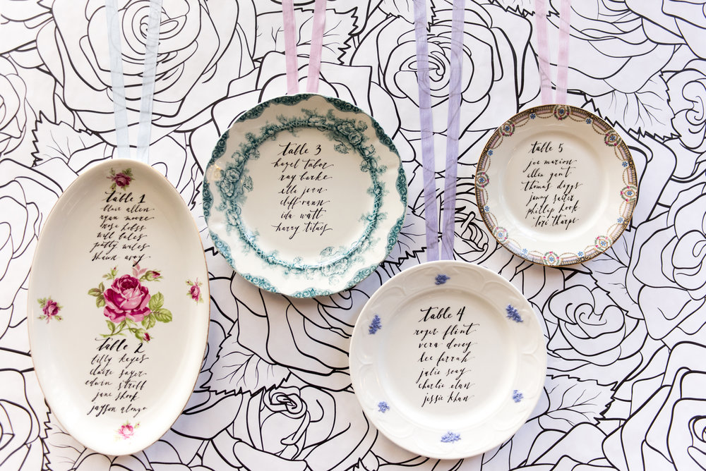 Something borrowed + seating chart display:  re-purposing vintage plates can be an unexpected and fresh seating chart display for your guests. (It can also be extra-special if they are a symbolic representation of someone in the family).  Photo:  5Ive 15ifteen   Calligraphy:  The Lettering Studio