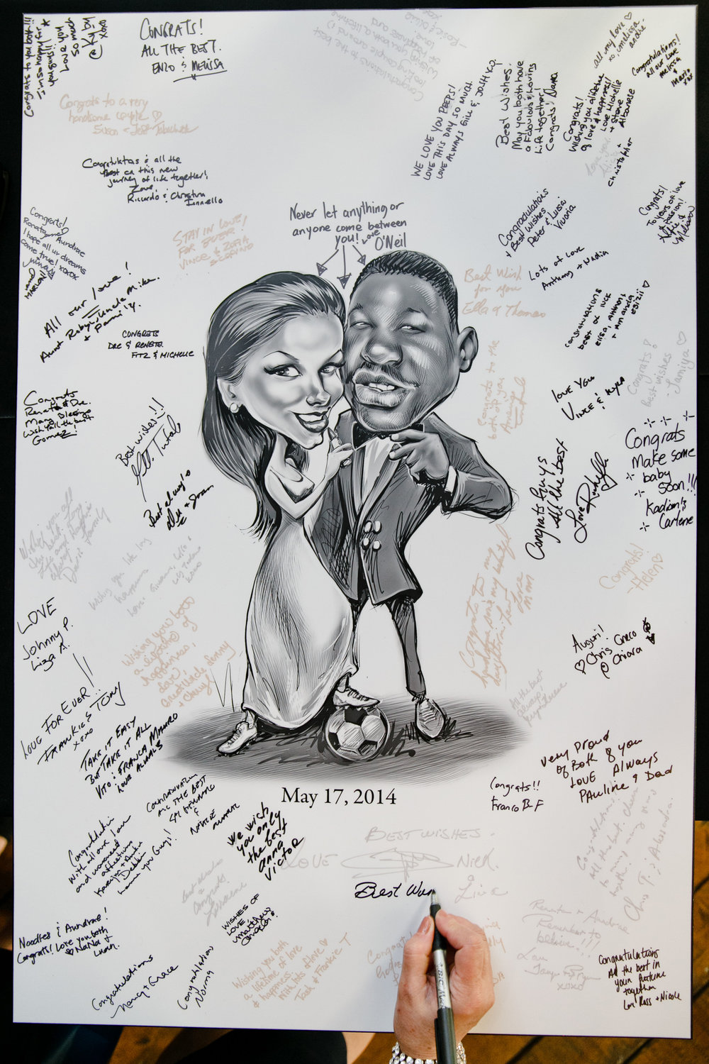 A caricature guestbook!  This is a fun alternative to the traditional guestbook for guests to leave a special note. (Personalize it even more by adding elements that reflect you, ahem, soccer lovers!)  Photo: Boyfriend/Girlfriend
