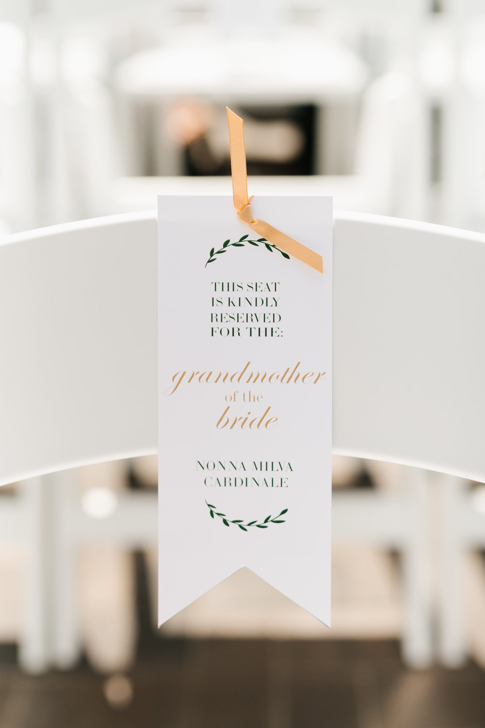 Customize your reserved signs!  Let those VIPs of the wedding really feel extra special with ceremony reserved signs that are custom to each person.  Photo:  Mango Studios   Reserved Signs: RDT Events