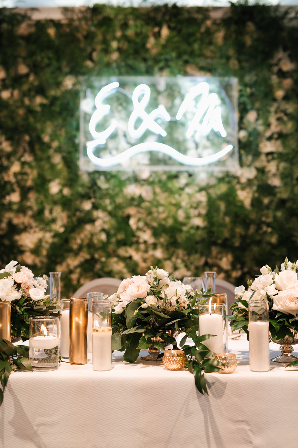 Light it Up!  The trendy, vibrant lights can boost your reception space, creating an ambient celebration vibe. Aside from the appeal of cool photo-ops, neon signs are functional, and design-savvy couples can later incorporate them into their newlywed homes.  Photo:  Mango Studios   Neon Sign: RDT Events