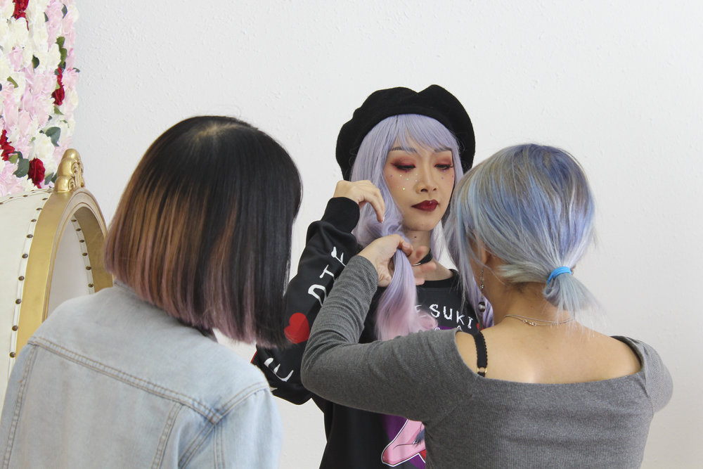 Adjusting model Nhi's hair. With Stylist Eileen. Wearing Diesuki Sweater.