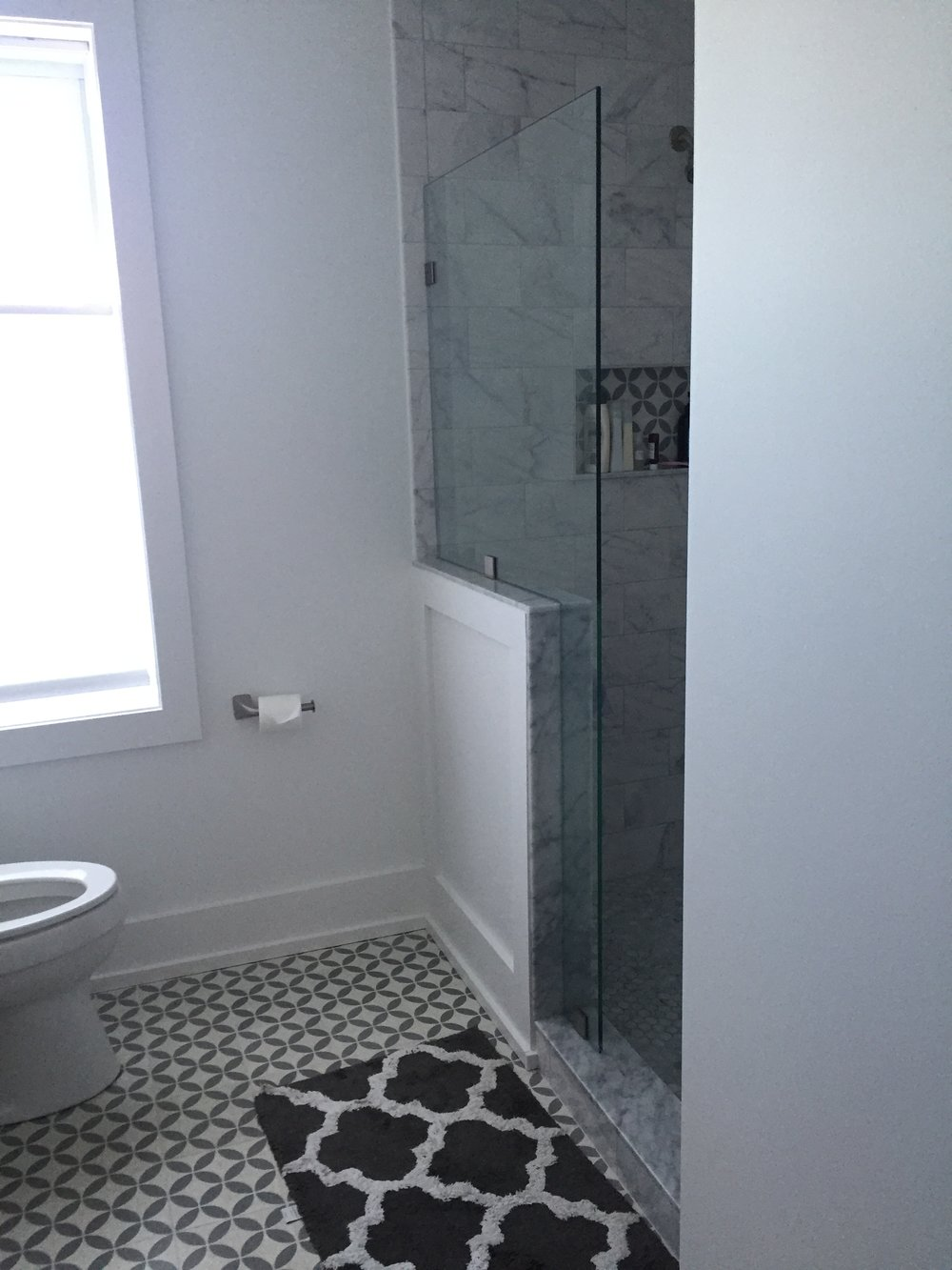 The before-and-after shots of our bathroom renovation