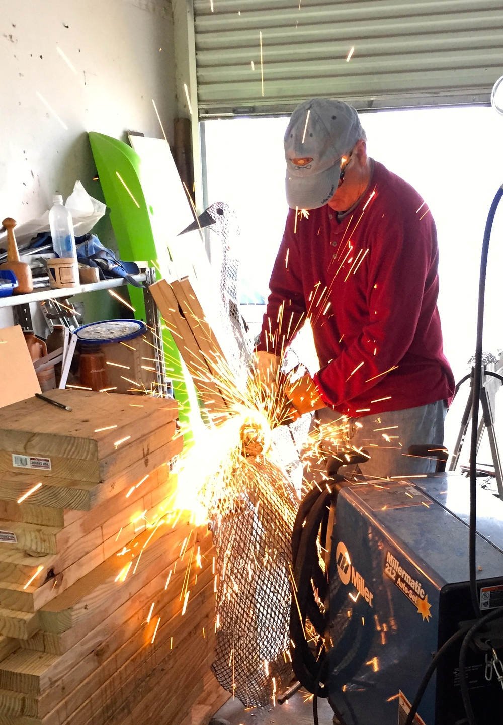 Jim swaim cuts the metal for a sculpture he is making