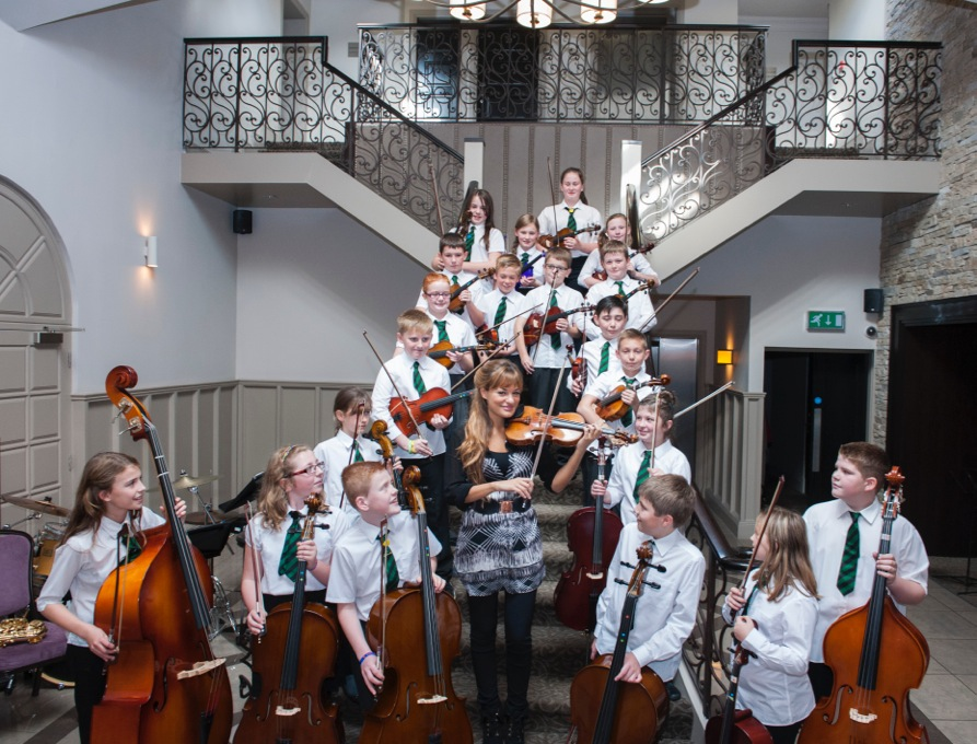The Cumnock Tryst Nicola Benedetti with pupils of Greenmill Primary in the dumfries arms, credit Richard Campbell.jpeg