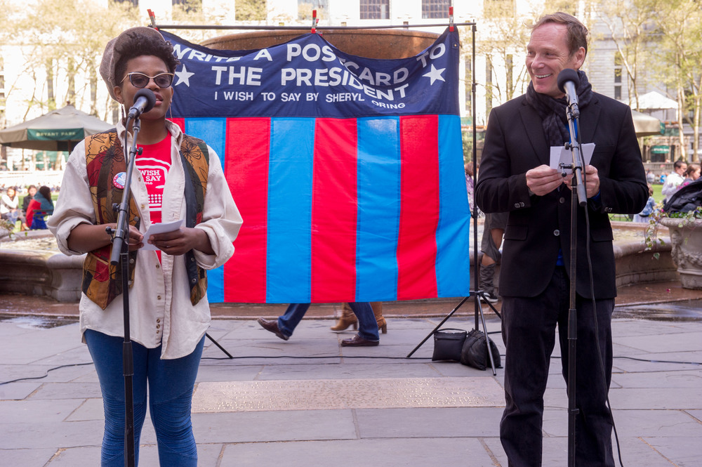 Madelynn Poulson and Hans Tester read messages to the presidential candidates dictated at Bryant Park. Photo by Christian Carter-Ross.