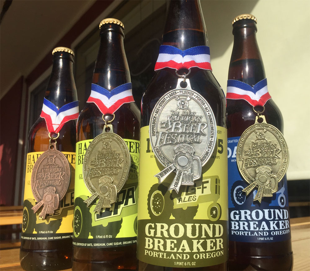 Four years, four medals. From left to right. Harvester Brewing Pale Ale (2012 GABF Bronze, Gluten Free), Harvest Brewing IPA No. 1 (2013 GABF Gold, Gluten Free), Ground Breaker IPA No. 5 (2015 GABF Silver, Gluten Free), and Ground Breaker Dark Ale (2014 GABF Gold, Gluten Free).