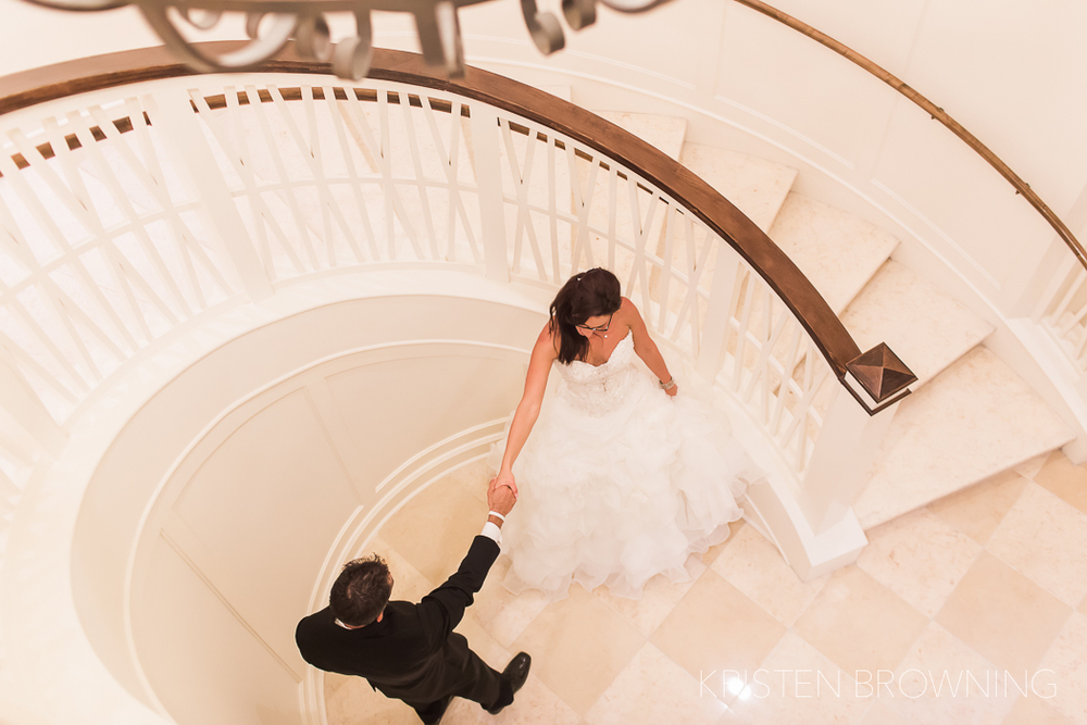 The spiral staircase + bride and groom = stunning!