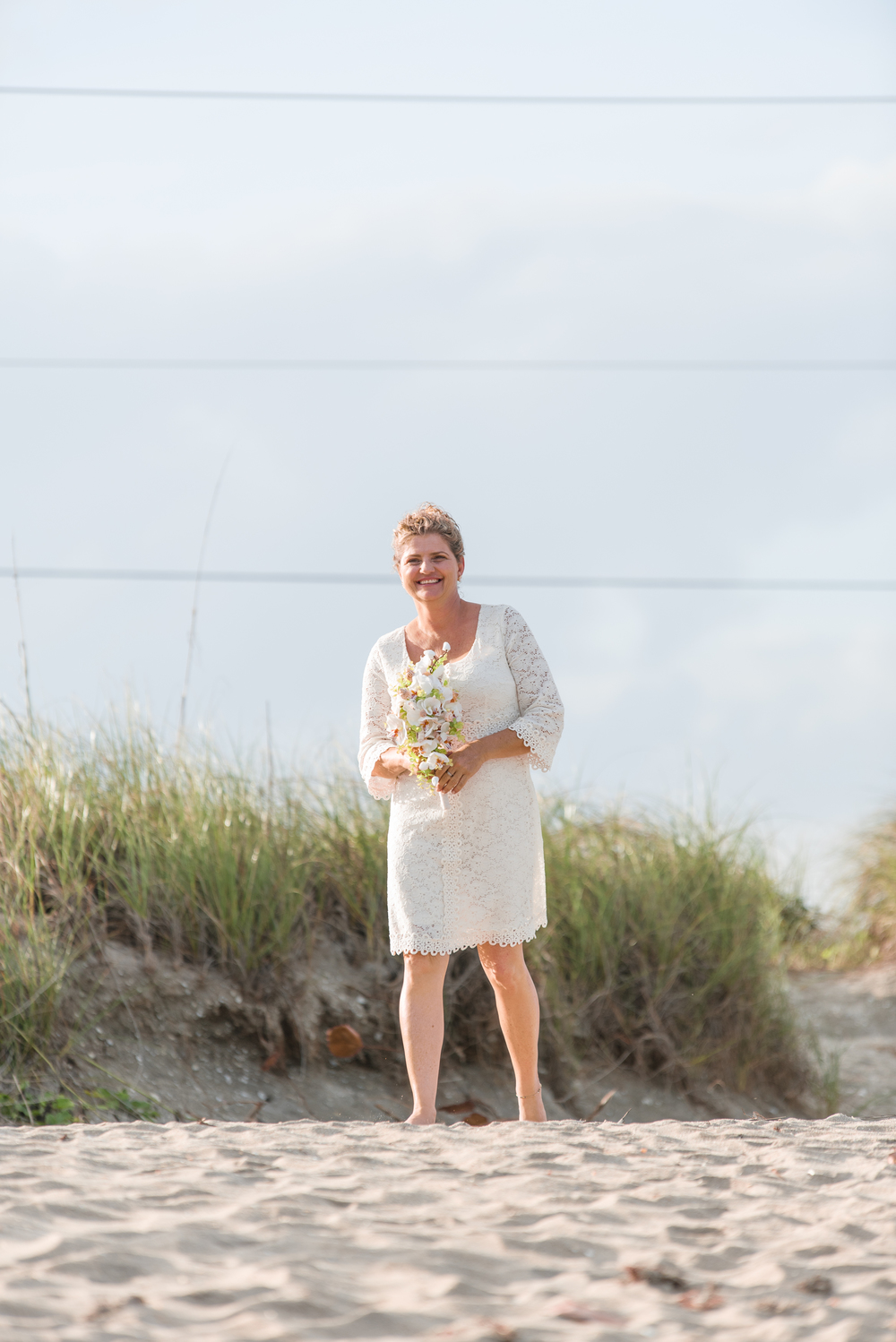 bride-with-flowers-on-beach