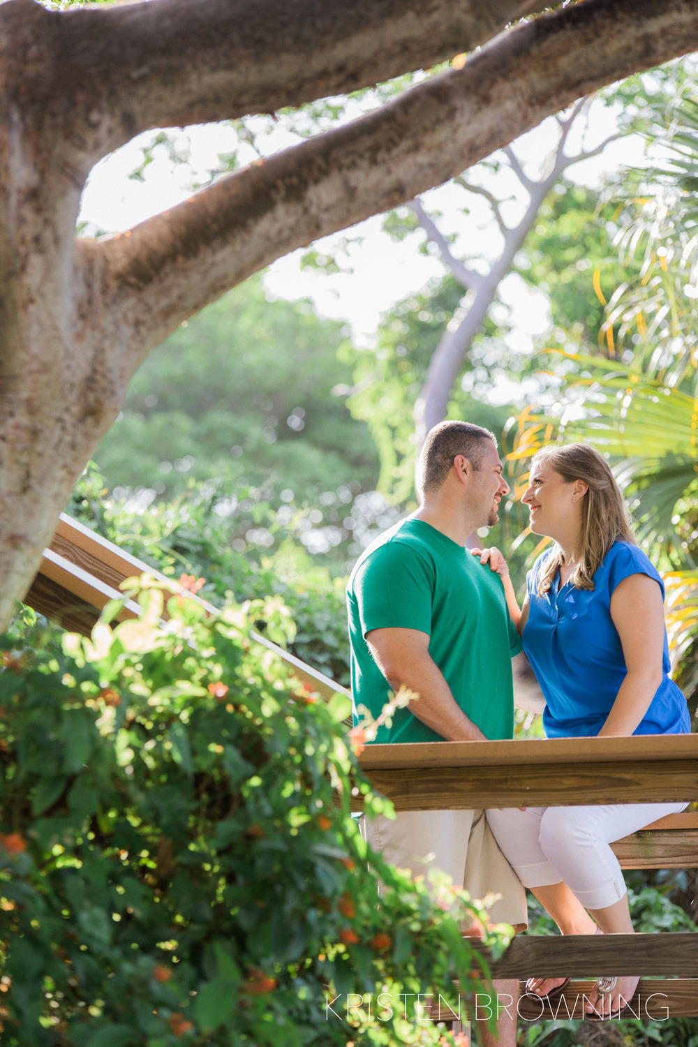 dubois-park-engagment-photos-sitting-on-rail