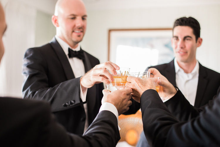 Toast with groomsmen at Coconut Palm Inn in Tavernier, Fl