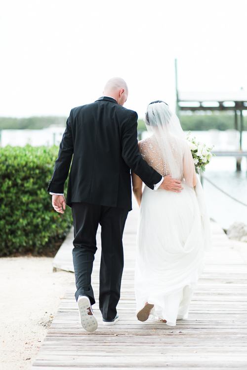 Bride and groom walking down the dock at Coconut Palm Inn in Tavernier, FL