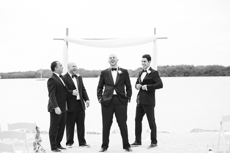 Groom laughing with groomsmen at Coconut Palm Inn in Tavernier, FL
