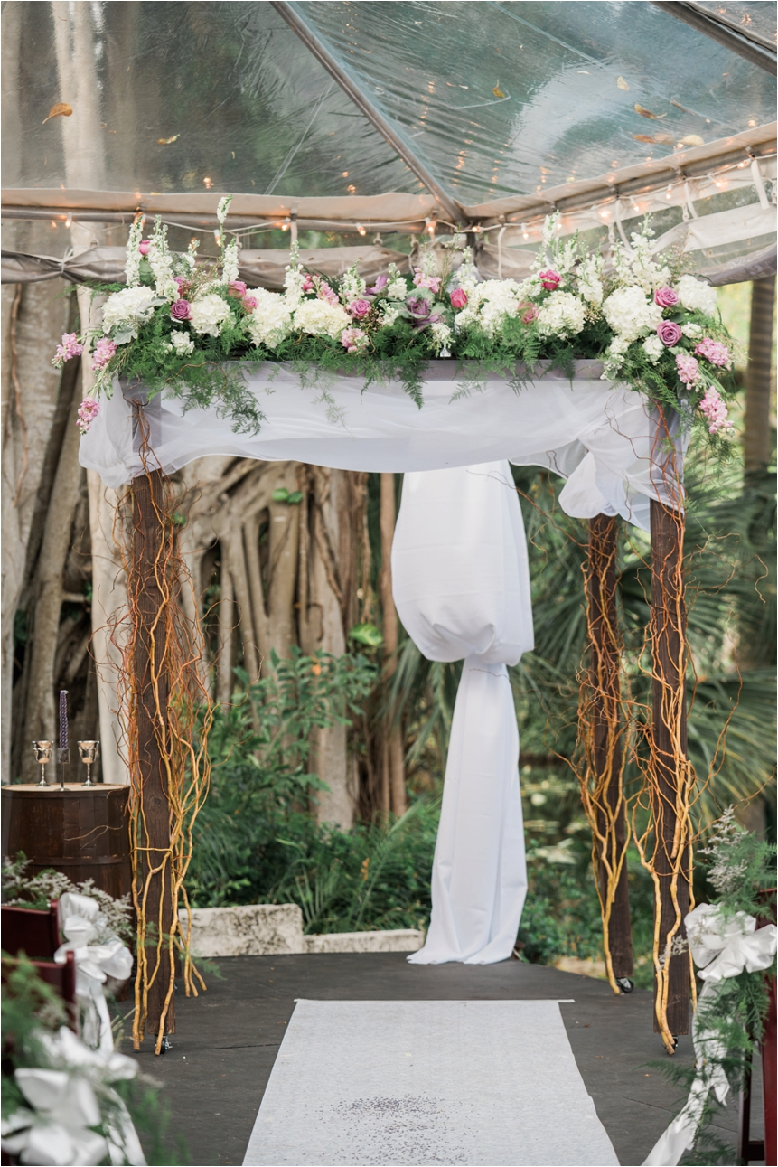 Check out those florals on that chuppah!
