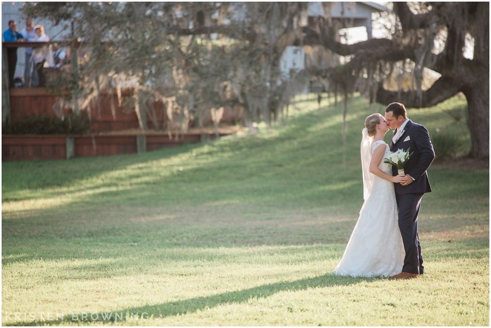 up-the-creek-farms-kissing-in-open-field