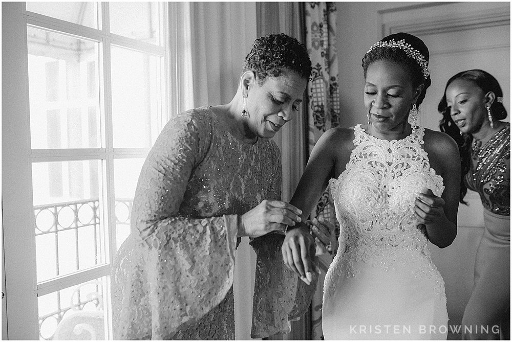 This is always a special moment for the bride's mom. I love that Andrea's sister is helping her too!