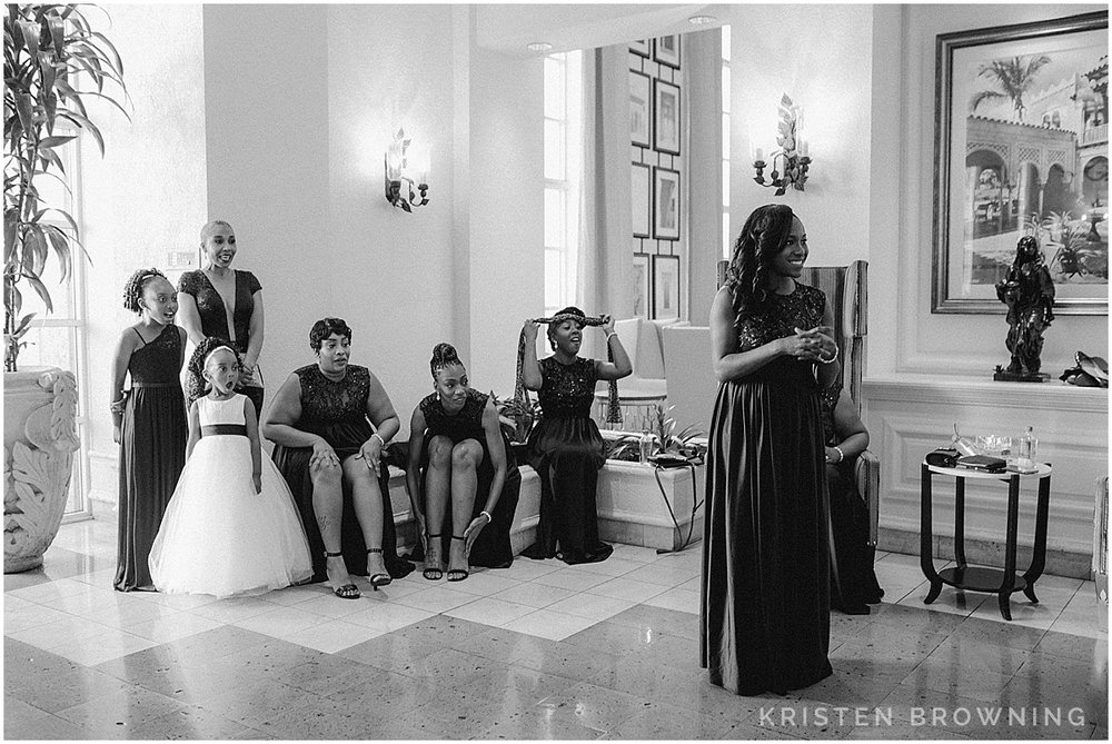 The moment when the bride came out of the elevator and her entourage lost their minds over how gorgeous she looked!