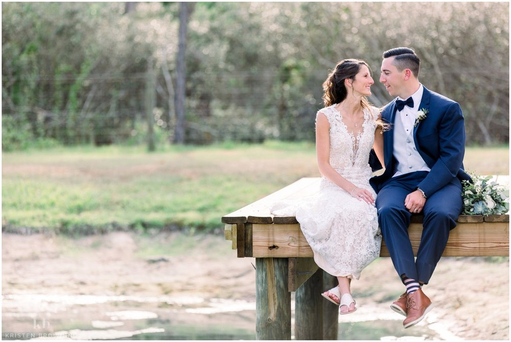 bride-and-groom-sitting-on-dock-south-florida-wedding-photographer_0033.jpg