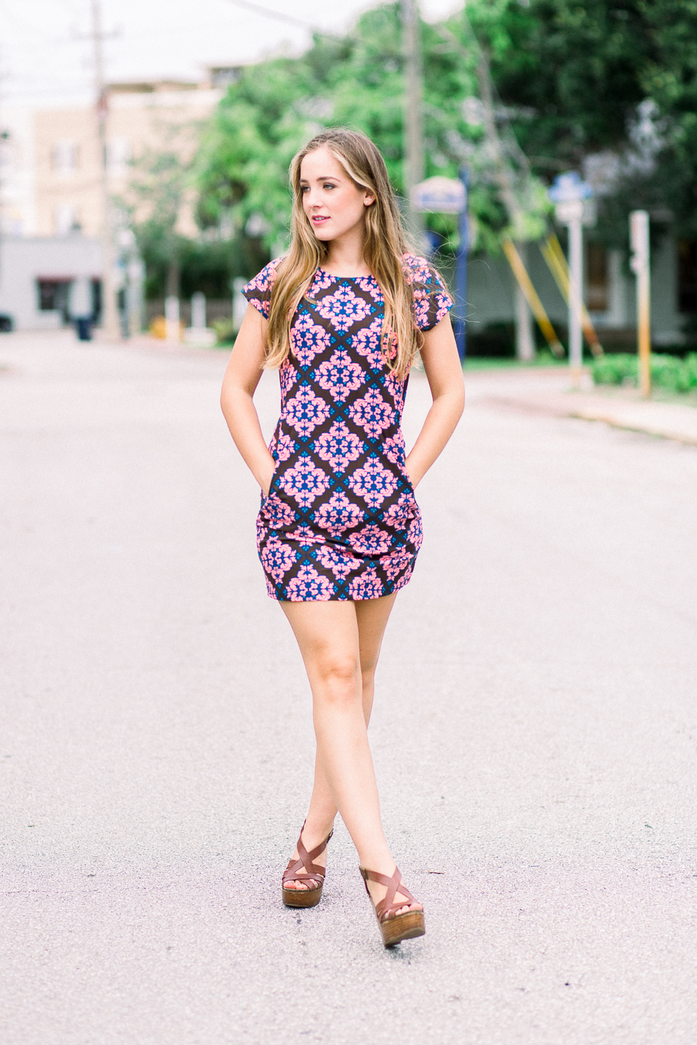 Girl walking in road wearing a patterned dress