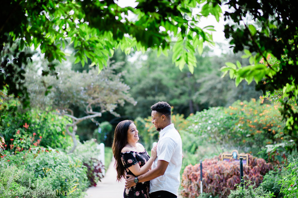 Engagement Photo of couple standing chest to chest in PSL botanical gardens with greenery framing the photo