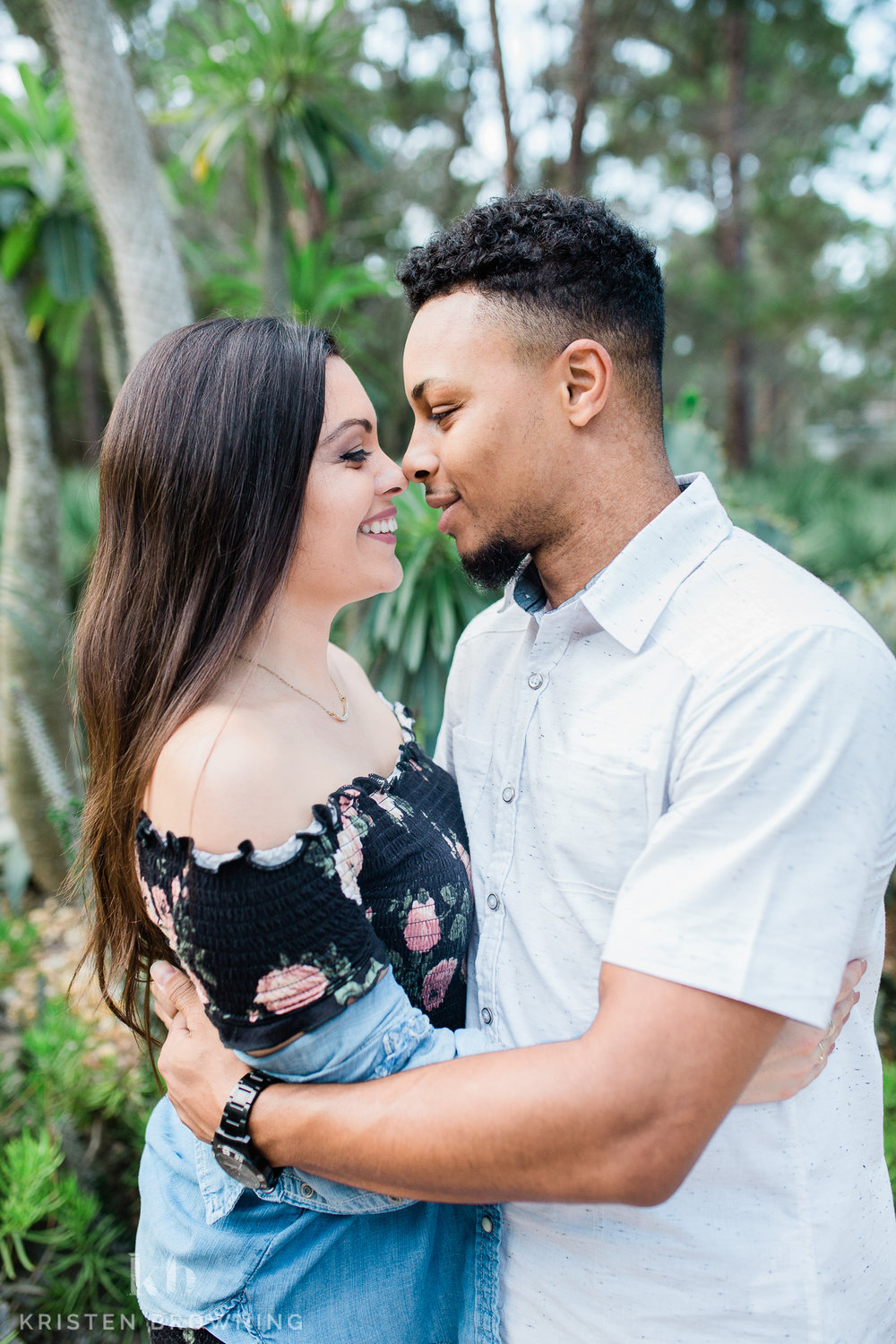 Engagement photo forehead to forehead in the cactus garden at PSL Botanical Gardens