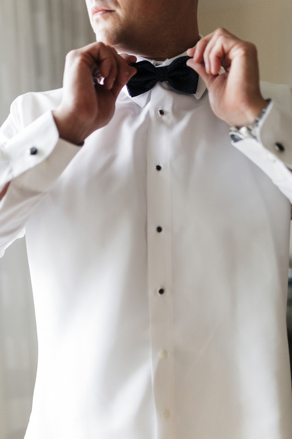 boca resort hotel groom preparation adjusting bow-tie