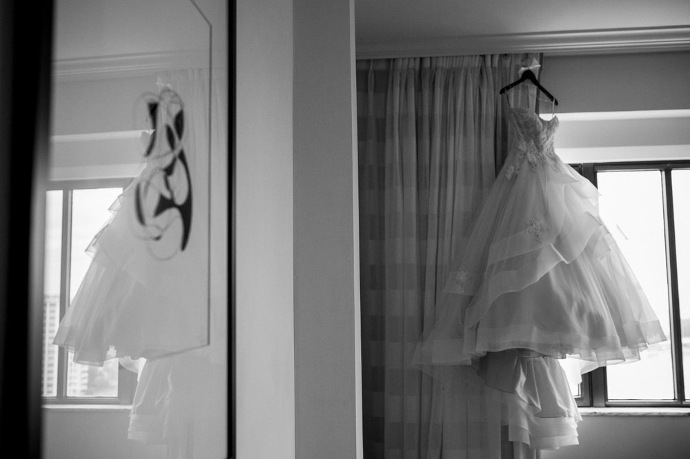 Monique Lhuillier wedding dress hanging in Boca Resort Hotel