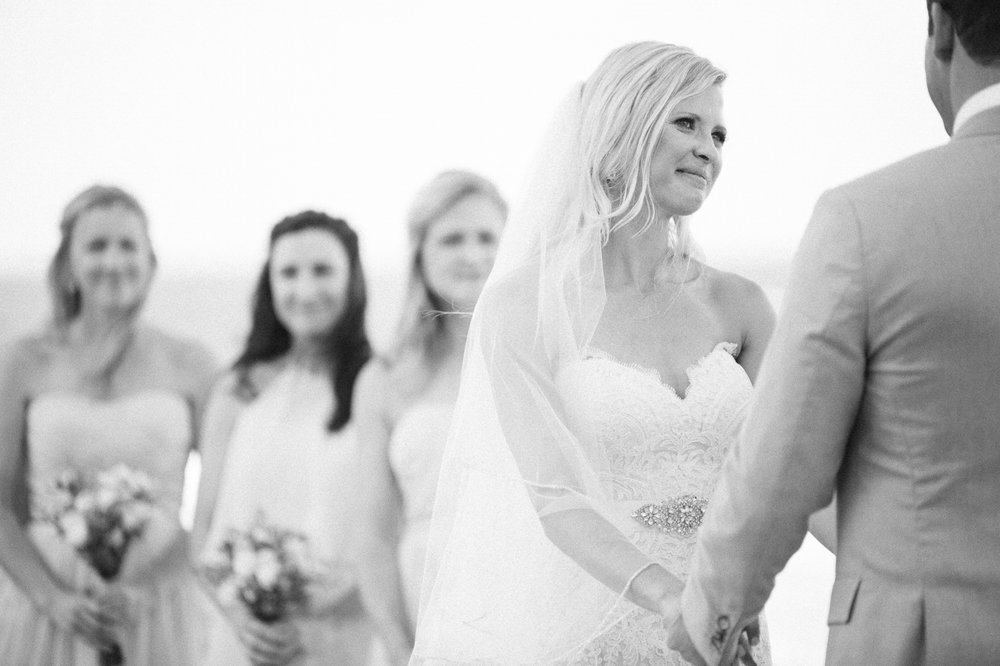 Bride and groom holding hands saying vows in Fort Lauderdale