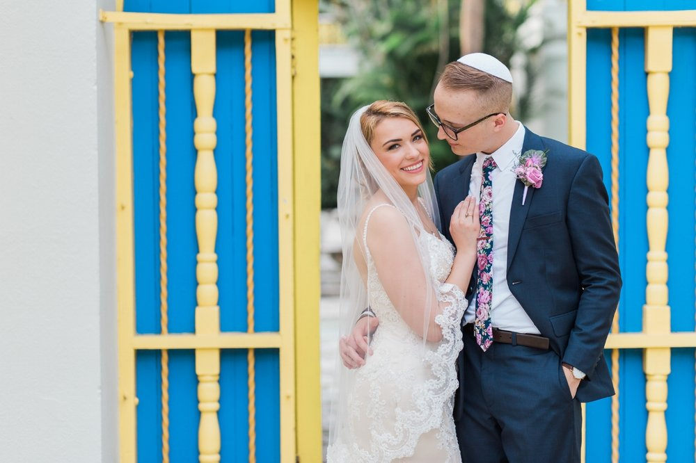 Bride and groom posing outside of the Bonnet House