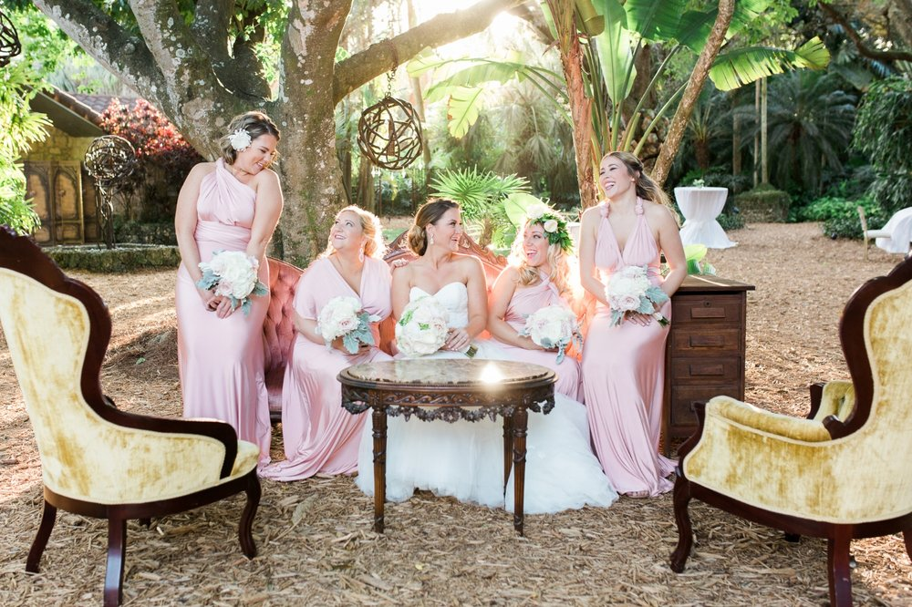 Laughing bridesmaids in pink dresses at Cooper Estate