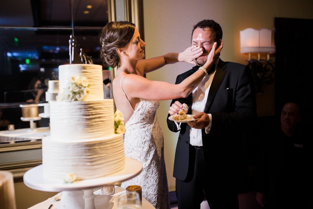 Bride smashes cake into groom's face at Jupiter Beach Resort