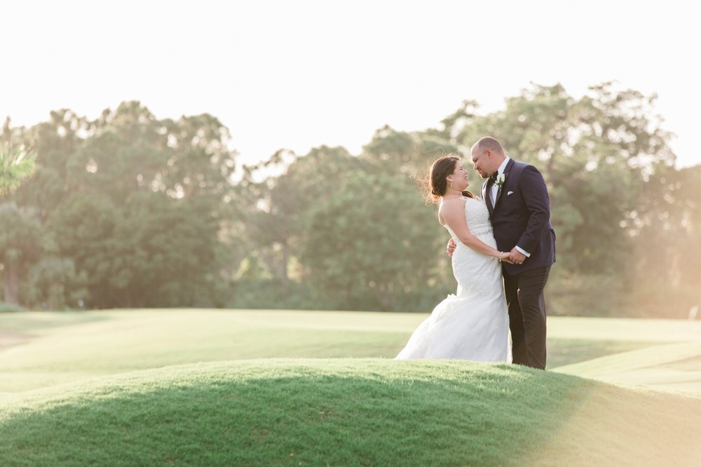 Sunset portrait of bride and groom on golf course in Hobe Sound, FL