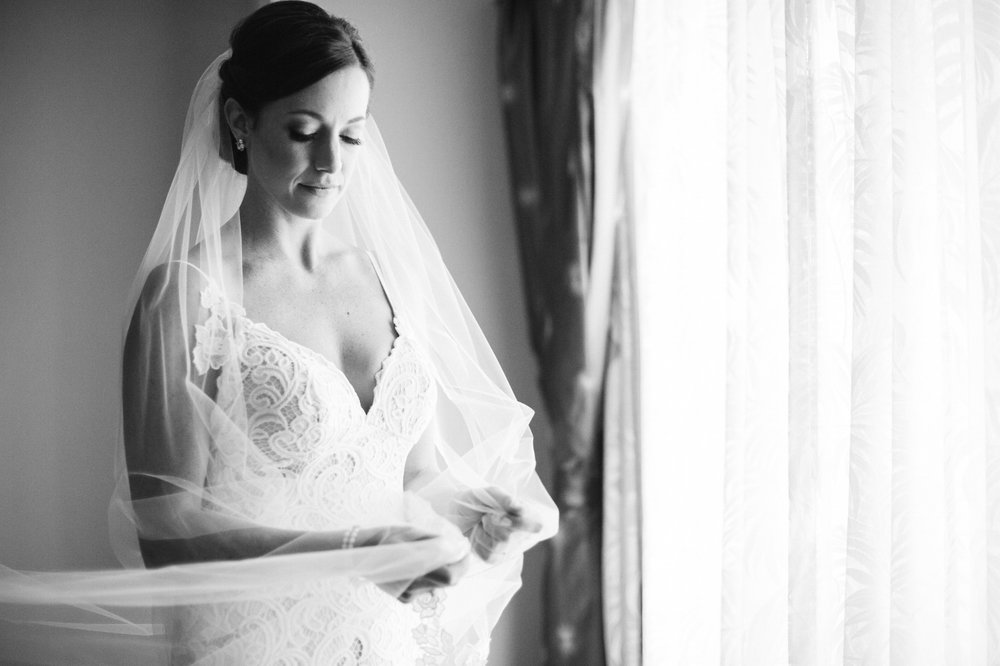 Bride holds veil for a portrait at Jupiter Beach Resort