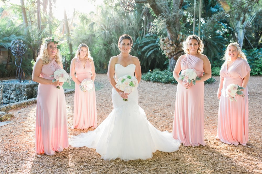 Bride and bridesmaids pose for portrait at the Cooper Estate