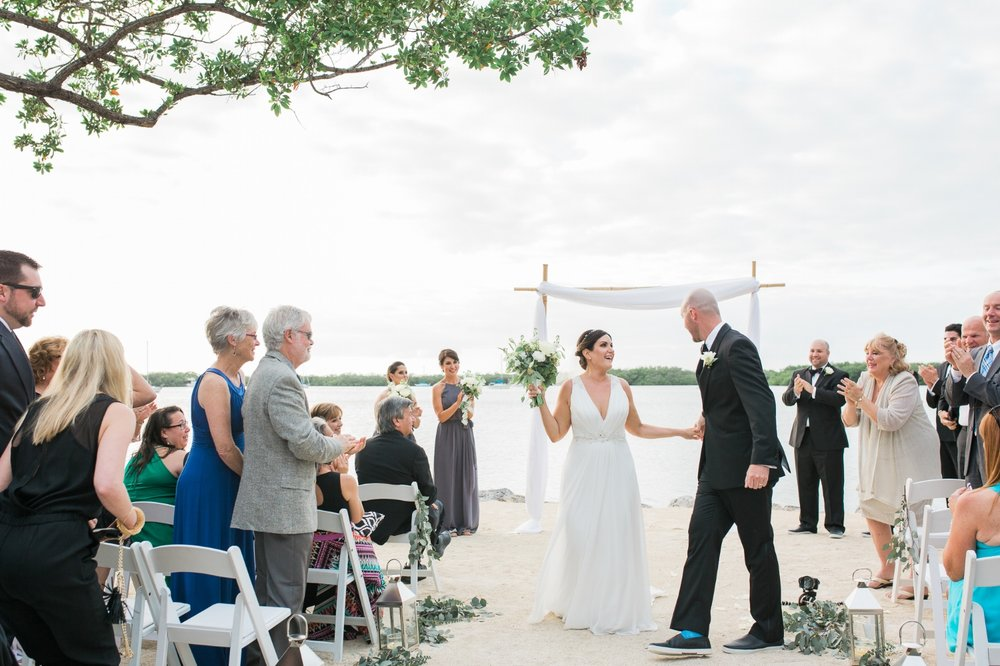 Bride and groom are just married at Coconut Palm Inn