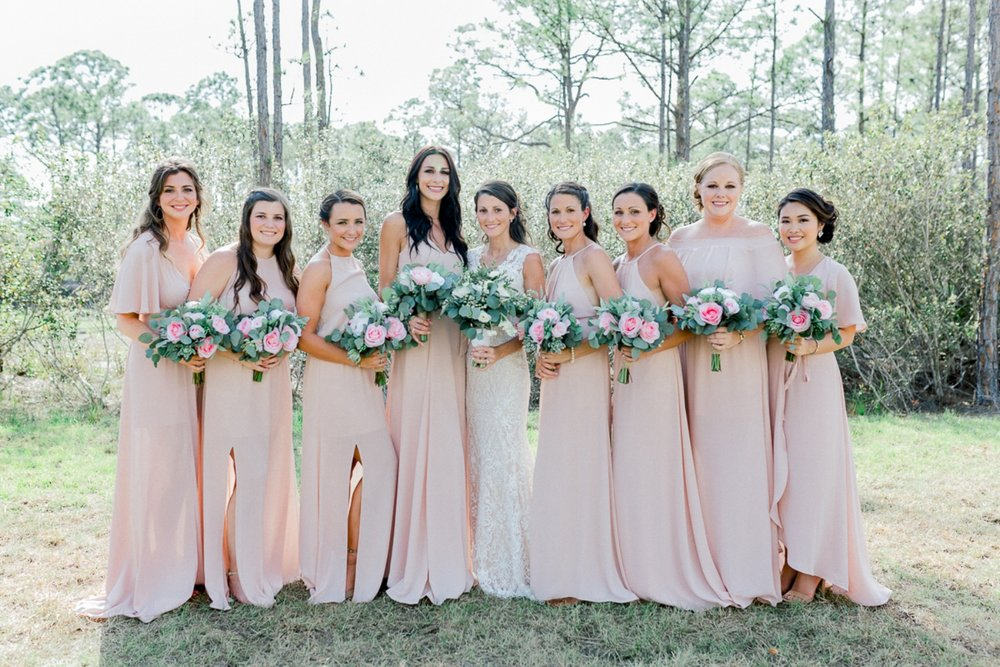 Bridesmaids in pink wedding dresses at farm wedding in Palm City FL
