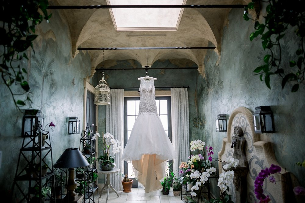 Dress hangs in orchid room in a mansion on Sailfish Point