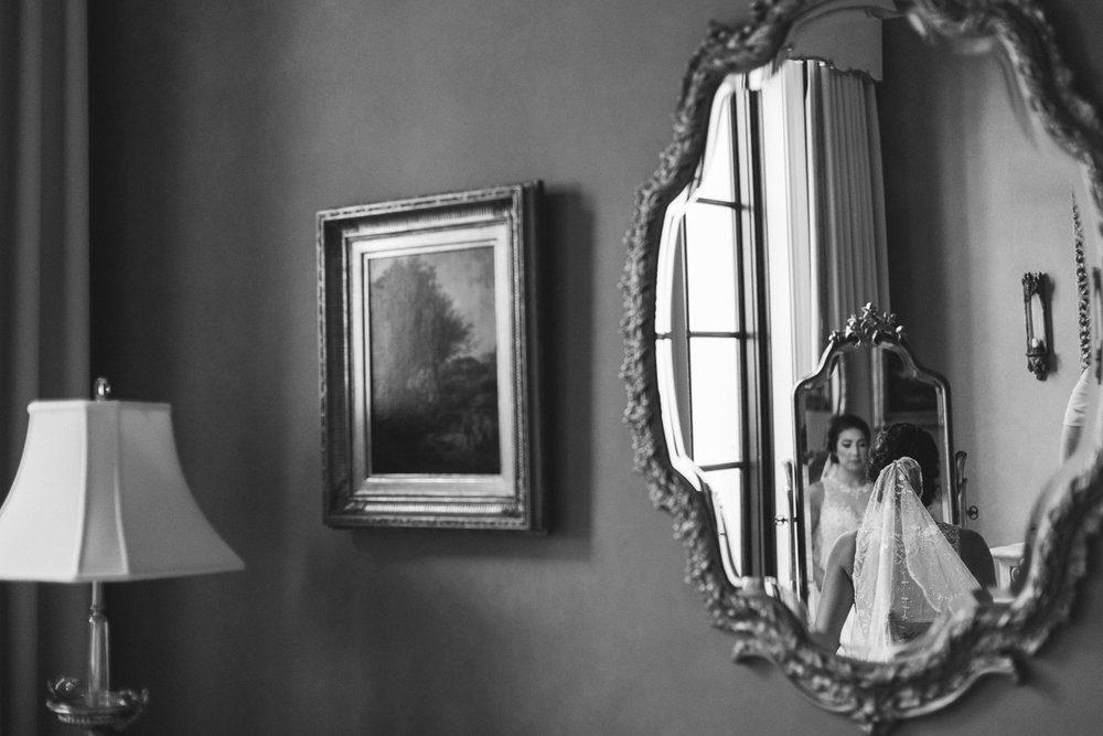 Bride gets ready in a mansion on Sailfish Point