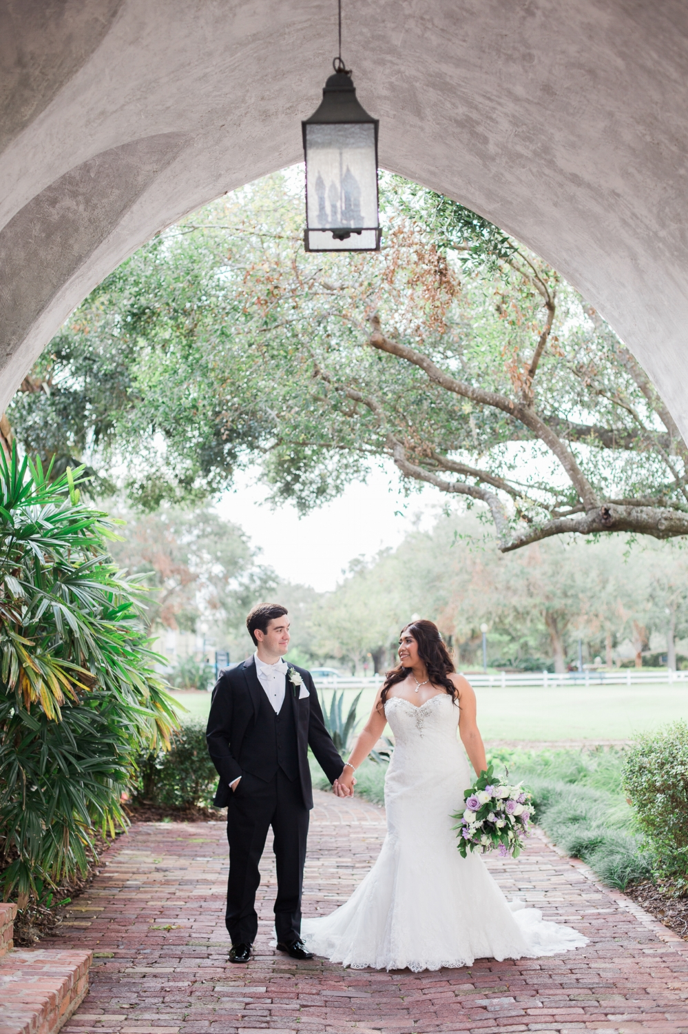 bride and groom under arch at Casa Feliz