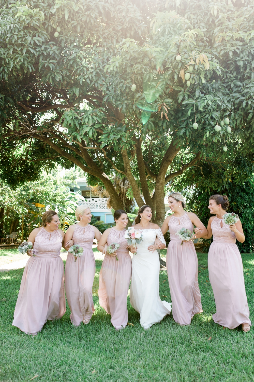 Bridesmaids in pink dresses at River Palms Cottages Jensen Beach, FL