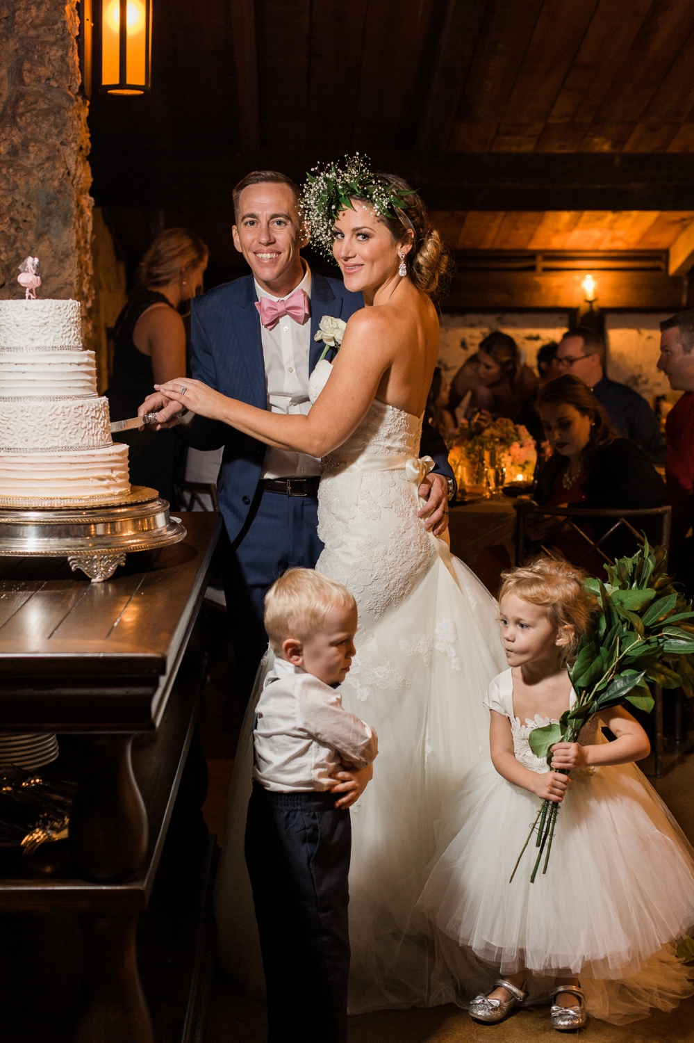Flower girl steals greenery from ring bearer during cake cutting at Cooper Estate