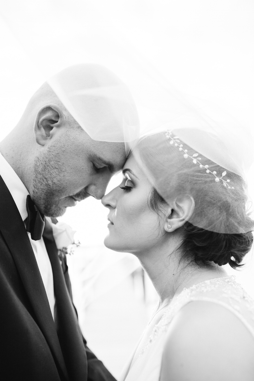 Bride and groom under veil at Coconut Palm Inn