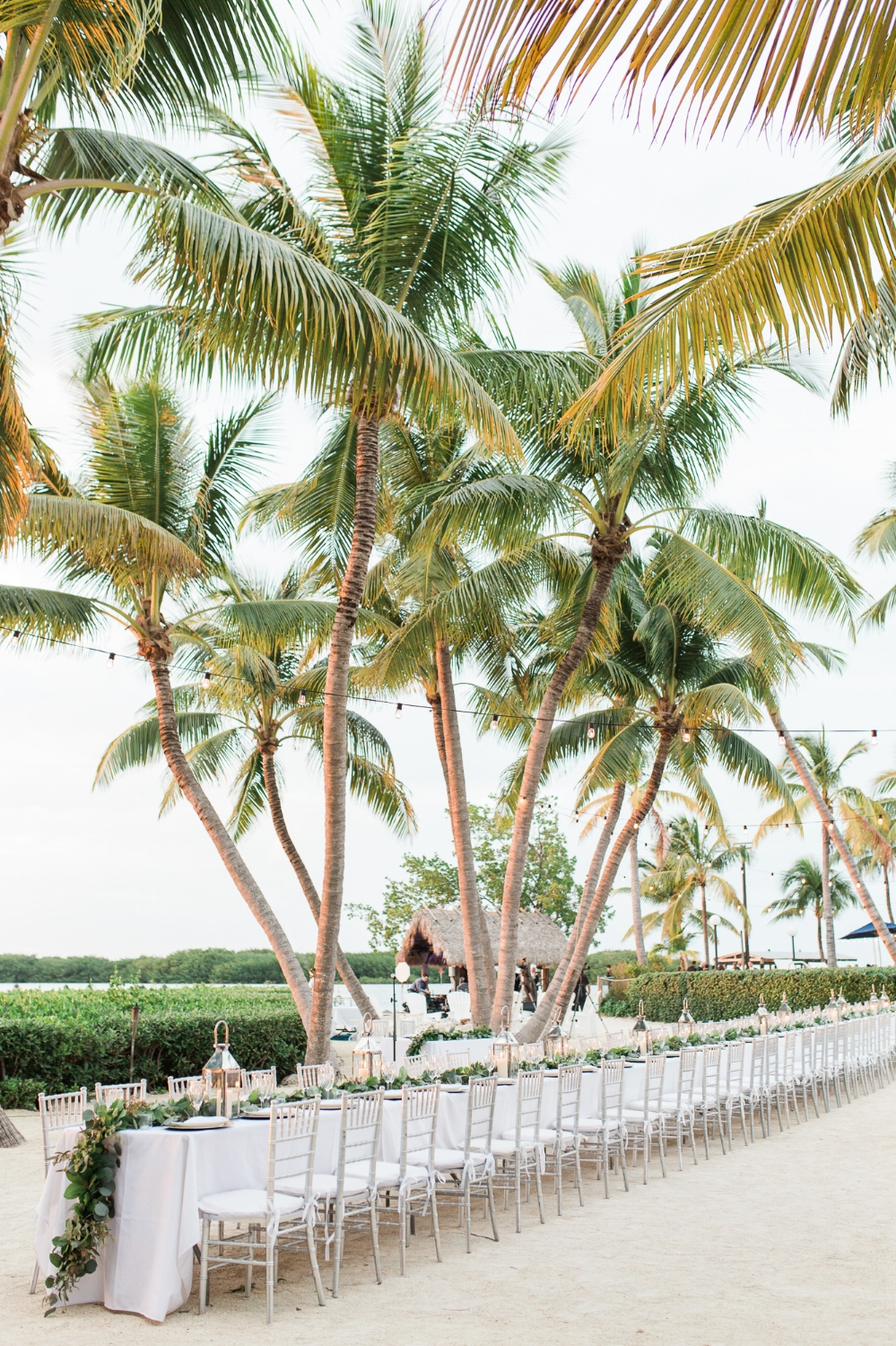 Family style reception table outdoors at Coconut Palm Inn in Tavernier, FL