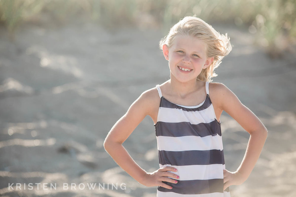 Young girl posing on the beach at golden hour