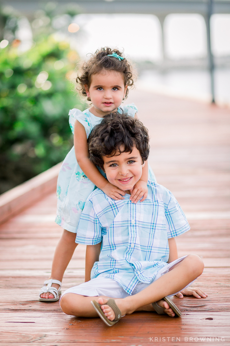 brother and sister posing for camera downtown stuart