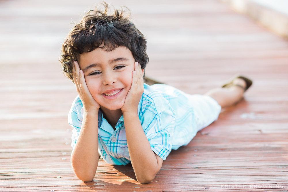 portrait of boy on dock downtown stuart