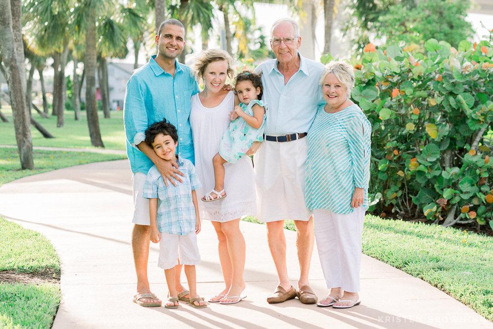 portrait of family on sidewalk in downtown stuart