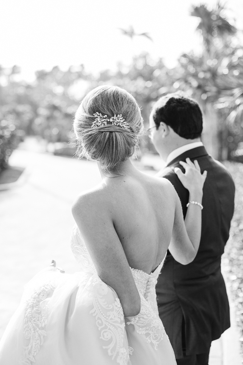 Sweet moment between bride and groom at Jupiter Beach Resort