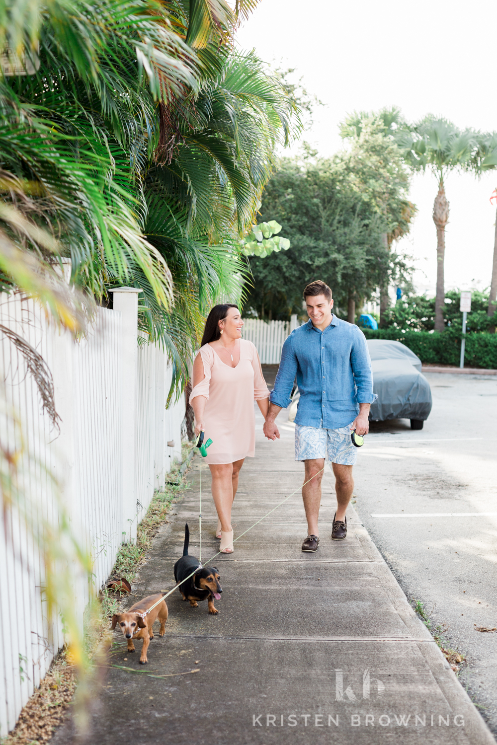 couple walking with dachshunds in Downtown Stuart